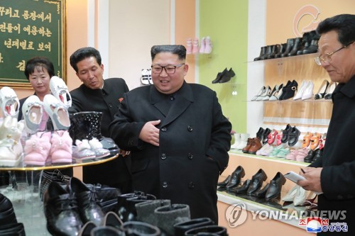 NK leader visits shoe factory