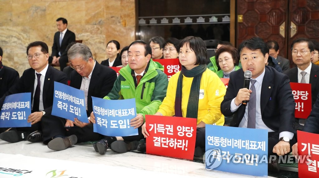 This photo, taken Dec. 6, 2018, shows lawmakers from three minor parties staging a sit-in protest at the National Assembly against bigger rivals' unilateral agreement on a revised bill on the government's 2019 budget. (Yonhap)
