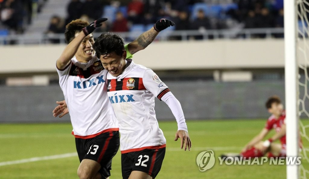 FC Seoul forward Cho Young-wook (R) celebrates with his teammate after scoring a goal against Busan IPark FC in the first leg of the K League promotion-relegation playoff at Gudeok Stadium in Busan on Dec. 6, 2018. (Yonhap)