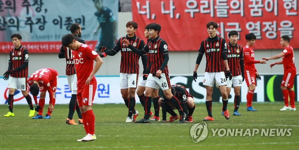 FC Seoul players celebrate after they edged Busan IPark FC to stay in the K League 1 following the second leg of the K League promotion-relegation playoff at Seoul World Cup Stadium in Seoul on Dec. 9, 2018. (Yonhap)