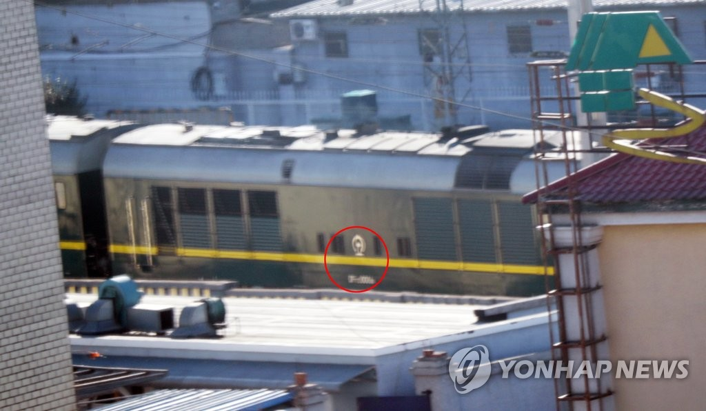 A North Korean train bearing the country's emblem (circled in red) arrives at Beijing Railway Station in the Chinese capital on Jan. 8, 2019. The train is carrying the North's leader Kim Jong-un, who began a four-day trip to China the previous day with his wife, Ri Sol-ju, at the invitation of Chinese President Xi Jinping. (Yonhap)