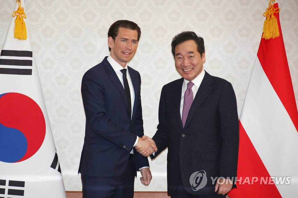 South Korean Prime Minister Lee Nak-yon (R) shakes hands with Austrian Chancellor Sebastian Kurz at the Government Complex in Seoul on Feb. 14, 2019. (Yonhap)