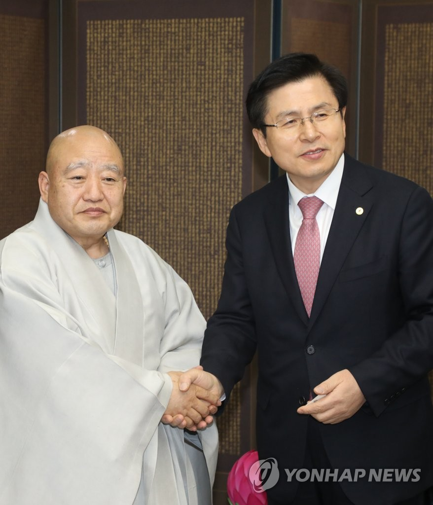 Opposition leader meets head of largest Buddhist sect