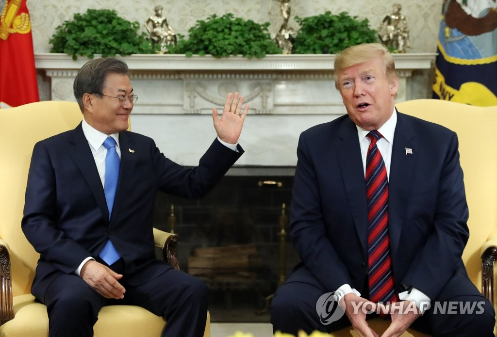 South Korean President Moon Jae-in (L) and U.S. President Donald Trump are seated together in the Oval Office at the White House on April 11, 2019. (Yonhap)