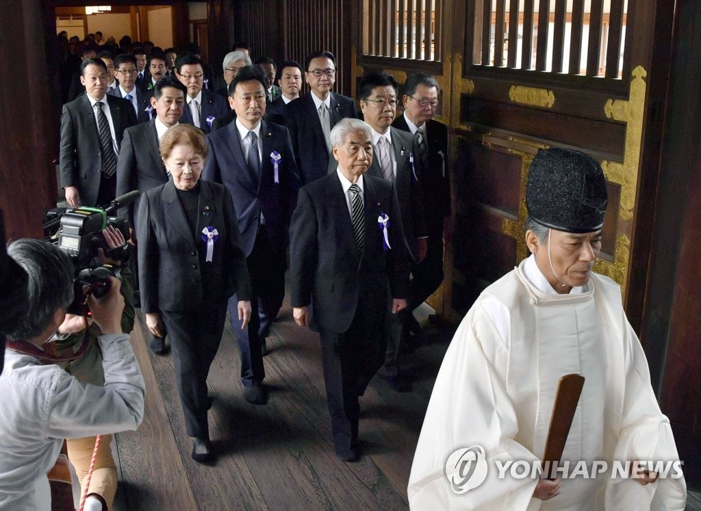 Japanese lawmakers pay a visit to Tokyo's Yasukuni Shrine on April 23, 2019, in this Kyodo News photo. (Yonhap)
