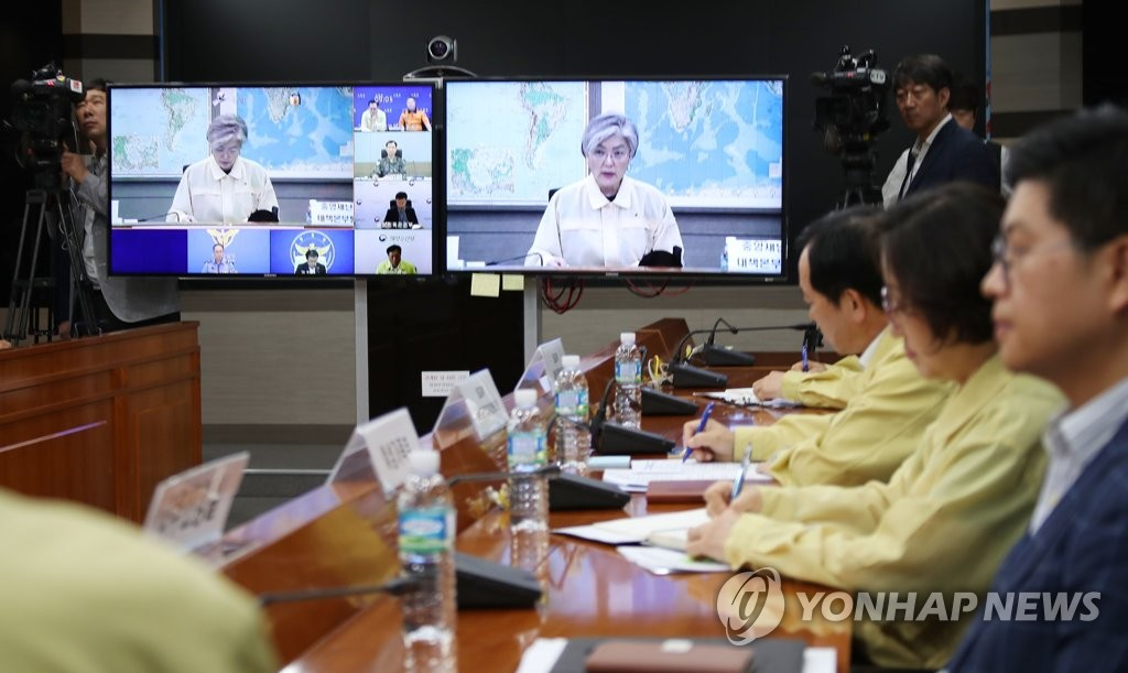 Foreign Minister Kang Kyung-wha (on the screen) convenes a disaster management meeting with related government agencies on June 3, 2019, over the deadly sinking of a tourist boat in Hungary that left seven Koreans dead and 19 others missing,