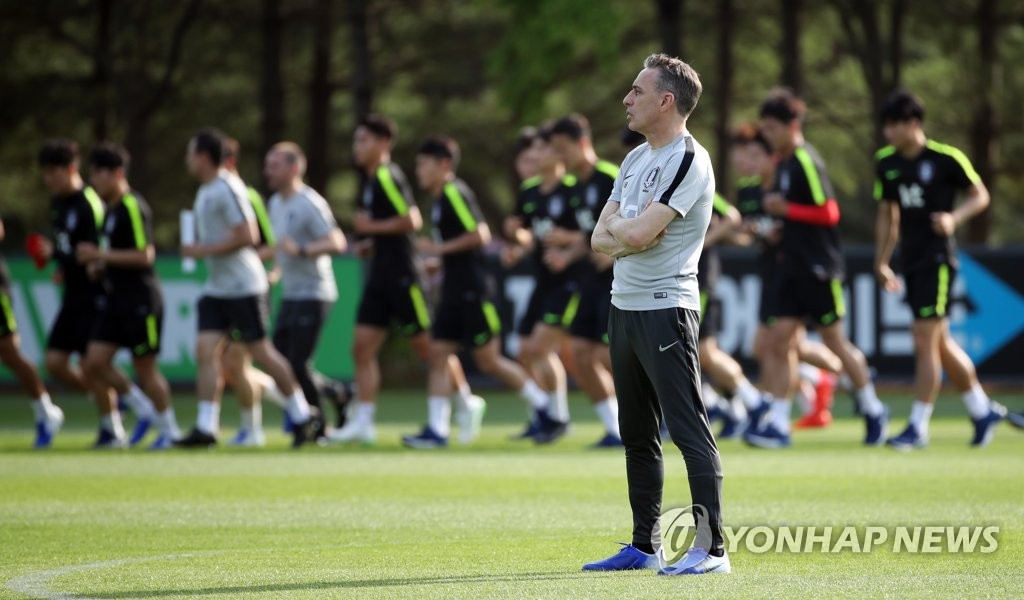 South Korea men's national football team head coach Paulo Bento looks out on the practice field at the National Football Center in Paju, Gyeonggi Province, on June 3, 2019. (Yonhap)