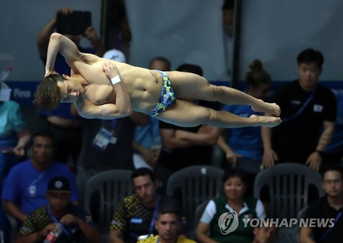 (Gwangju Swimming) Diver with Olympic Rings tattoo qualifies for Tokyo 2020