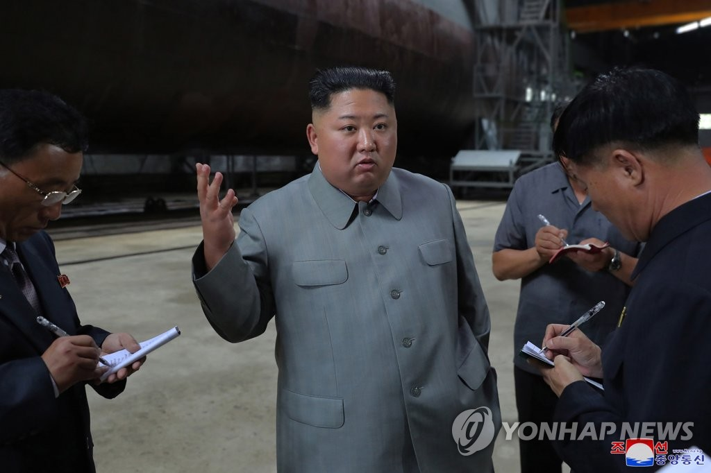 This photo, released by the Korean Central News Agency on July 23, 2019, shows North Korean leader Kim Jong-un speaking during an inspection of a newly built submarine. As is customary, the agency didn't provide the date or location. (For Use Only in the Republic of Korea. No Redistribution) (Yonhap)