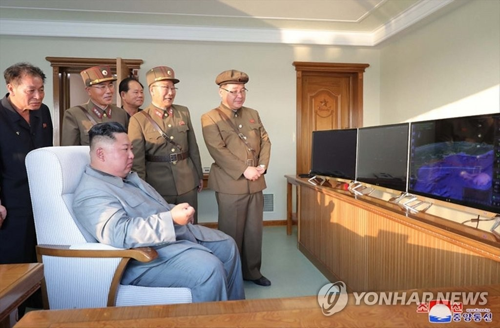 "North Korean leader Kim Jong-un looks at a monitor showing a missile launch from a site near the North's eastern coastal town of Wonsan on July 25, 2019, in this photo released by the Korean Central News Agency the following day. North Korea fired two short-range missiles into the East Sea, in what it says is a power demonstration of a ""new tactical guided weapon."" (For Use Only in the Republic of Korea. No Redistribution) (Yonhap)"