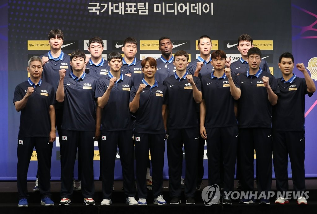 In this file photo from July 29, 2019, members of the South Korean men's basketball team pose for photos during their media day event in Seoul. (Yonhap)