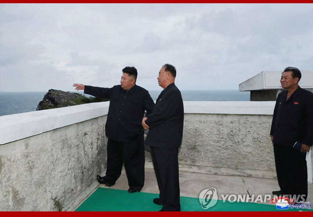 This photo released Aug. 11, 2019, by the North's Korean Central News Agency captures its leader Kim Jong-un (L) watching the test-firing of missiles that took place the previous day. (For Use Only in the Republic of Korea. No Redistribution) (Yonhap)
