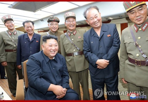 N.K. leader oversees latest missile firings