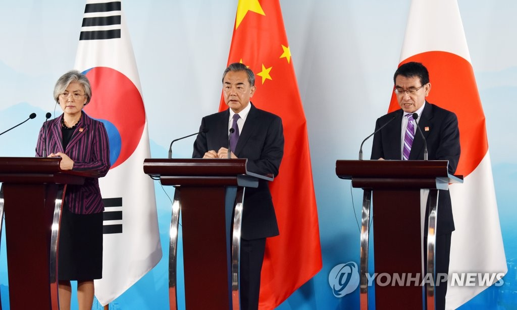 South Korean Foreign Minister Kang Kyung-wha (L) and her Chinese and Japanese counterparts, Wang Yi (C) and Taro Kono, hold a joint press conference after their talks in Beijing on Aug. 21, 2019. (Pool photo) (Yonhap)