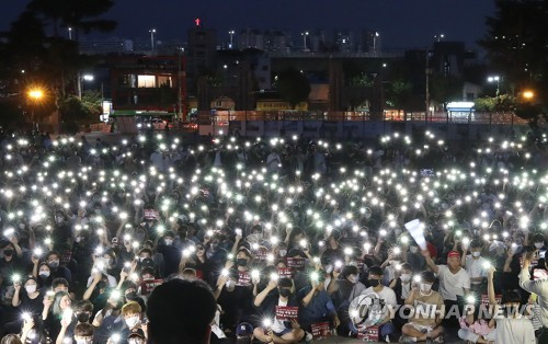 University students hold flashlight vigil