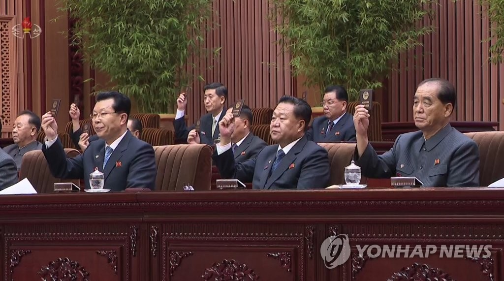 North Korea's top officials -- Choe Ryong-hae (C), president of the presidium of the Supreme People's Assembly (SPA) and first vice chairman of the State Affairs Commission (SAC); Premier Kim Jae-ryong (L); and Pak Pong-ju (R), vice chairman of the SAC -- gesture during the 2nd Session of the 14th SPA in Pyongyang on Aug. 29, 2019, in this photo released by the North's Korean Central Broadcasting Station. (For Use Only in the Republic of Korea. No Redistribution) (Yonhap)