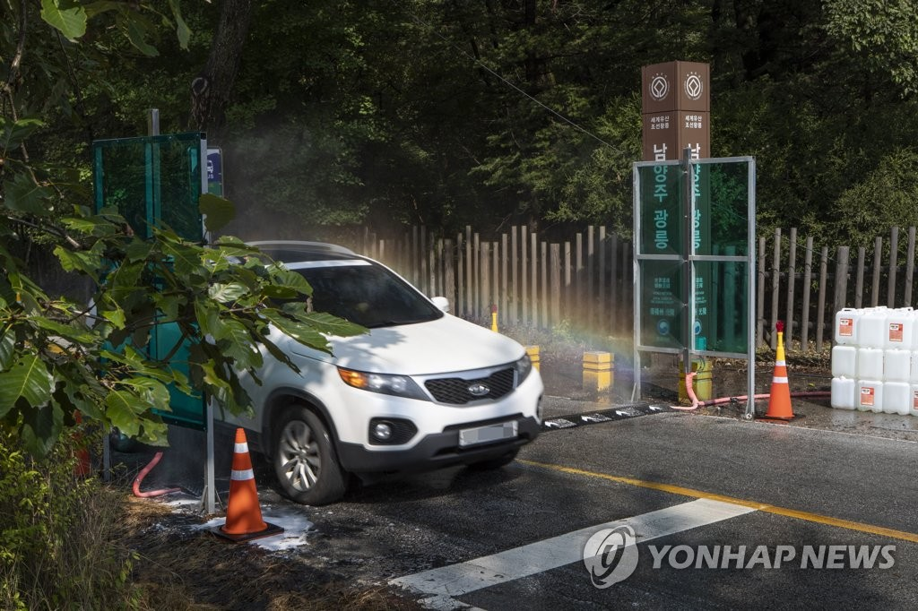 In this file photo taken on Oct. 8, 2019, a car passes through a quarantine checkpoint in Namyangju, Gyeonggi Province, which has been set up prevent the spread of African swine fever. (Yonhap)