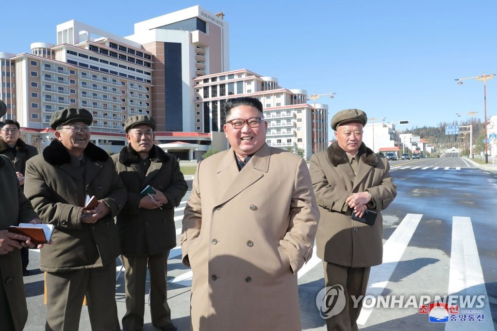 North Korean leader Kim Jong-un smiles during an inspection of construction sites in Samjiyon County near the country's tallest mountain of Paektu in this photo provided by the Korean Central News Agency on Oct. 16, 2019. (For Use Only in the Republic of Korea. No Redistribution) (Yonhap)