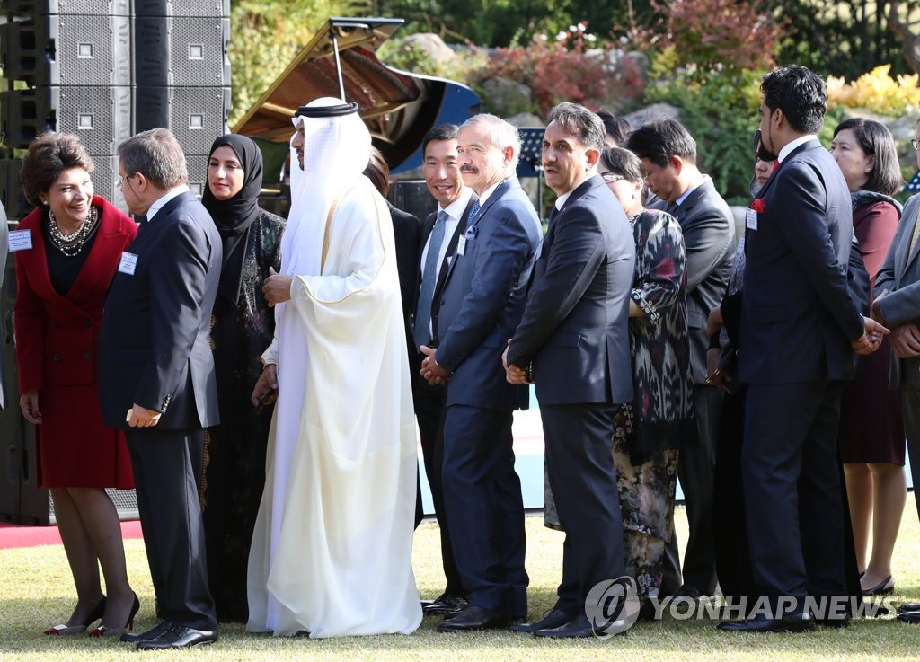 Foreign ambassadors wait in line to be greeted by President Moon Jae-in during a Cheong Wa Dae garden reception in Seoul on Oct. 18, 2019. (Yonhap)