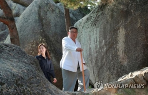 N.K. leader's wife appears in state media after 4-month absence