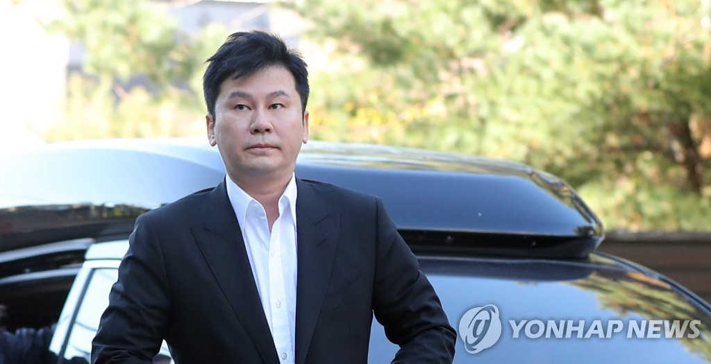 This image shows YG founder Yang Hyun-suk on his way to a police interrogation on Nov. 9, 2019. (Yonhap)