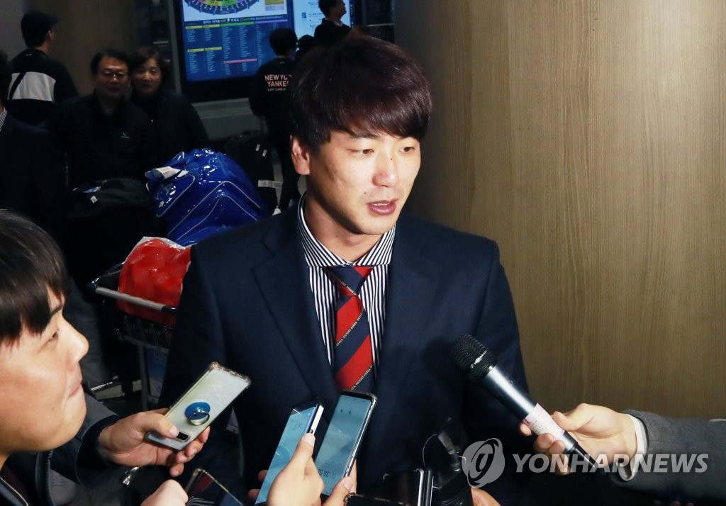 In this file photo from Nov. 18, 2019, South Korean pitcher Kim Kwang-hyun speaks to reporters at Incheon International Airport, west of Seoul, after returning home from the World Baseball Softball Confederation (WBSC) Premier12 tournament in Japan. (Yonhap)
