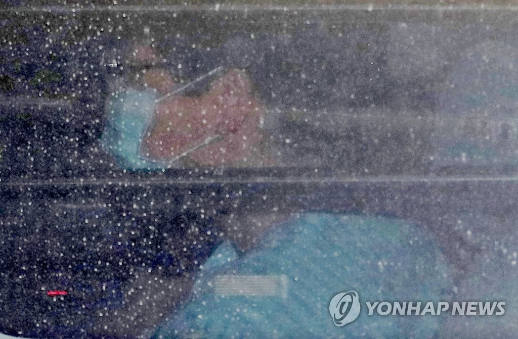A car carrying former President Park Geun-hye exits an underground parking lot at Seoul St. Mary's Hospital in southern Seoul on Dec. 3, 2019.