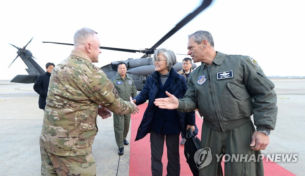 Foreign minister at U.S. military base