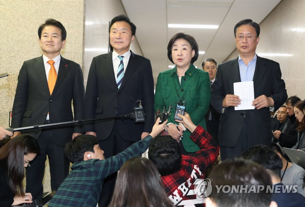 The chiefs of three minor parties and one splinter group announce their deal on electoral reform at the National Assembly in Seoul on Dec. 23, 2019. (Yonhap)