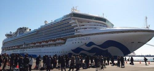 This photo, taken Feb. 11, 2020, shows the Diamond Princess cruise ship held in the Japanese port of Yokohama near Tokyo after the ship reported an infection of COVID-19 earlier in the month. (Yonhap)
