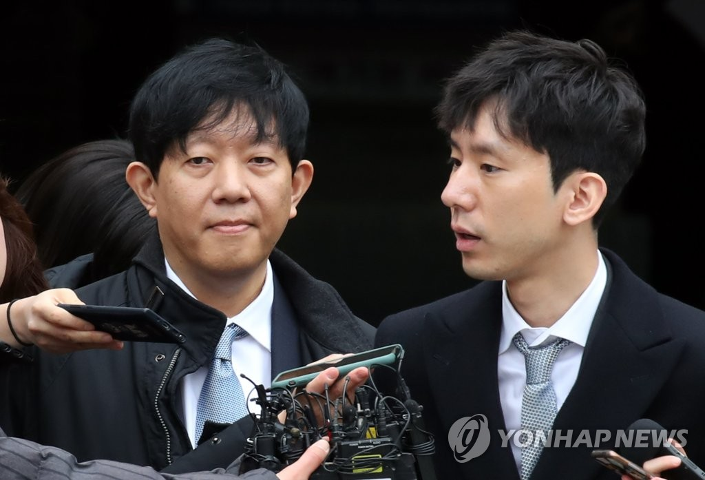 Lee Jae-woong (L), the chief of car-sharing app operator SoCar, and Park Jae-uk, who leads SoCar's subsidiary Value Creators & Company, answer questions from reporters on Feb. 19, 2020, after a Seoul court acquitted them over illegality of the app-based business. (Yonhap)