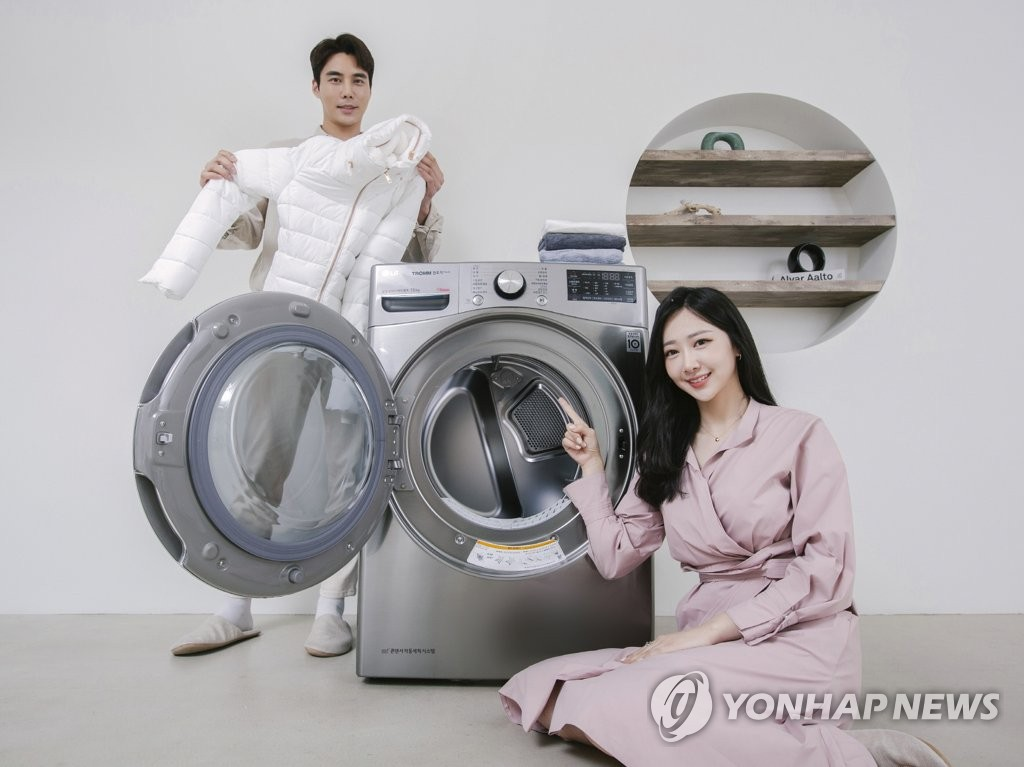 This photo provided by LG Electronics Inc. on March 5, 2020, shows models promoting the company's STEAM ThinQ dryer. (PHOTO NOT FOR SALE) (Yonhap)