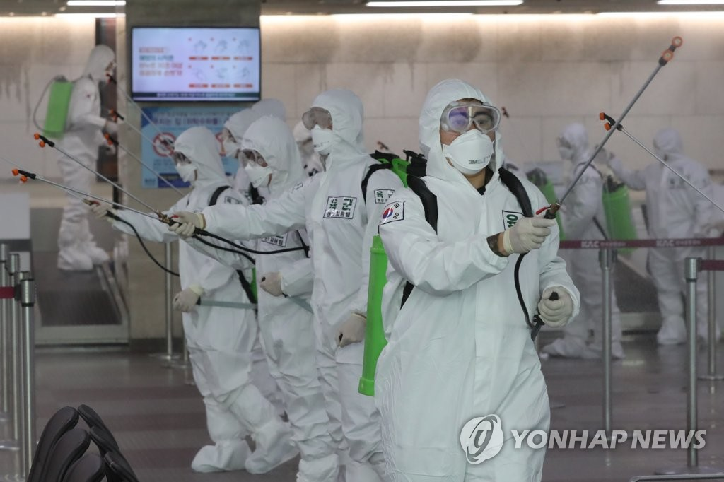 Soldiers disinfect Daegu International Airport on March 6, 2020, as part of measures against the new coronavirus. (Yonhap)