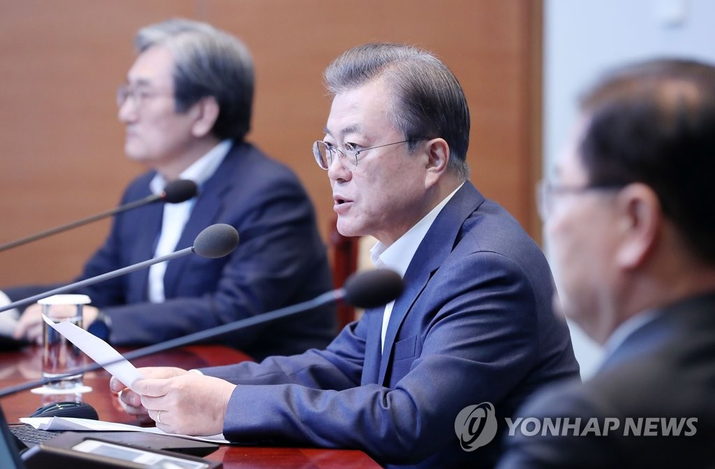 Moon says new infections slowing, but advises caution over excessive optimism