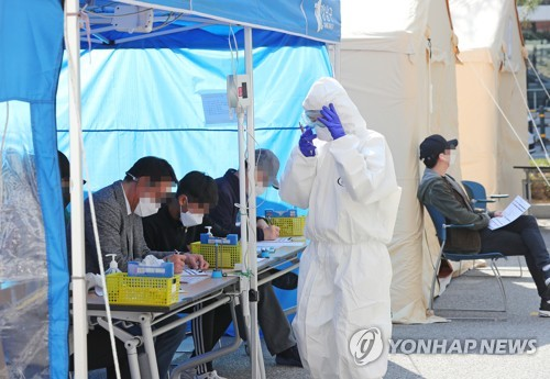 (URGENT) S. Korea reports 125 more cases of new coronavirus, total now at 9,786