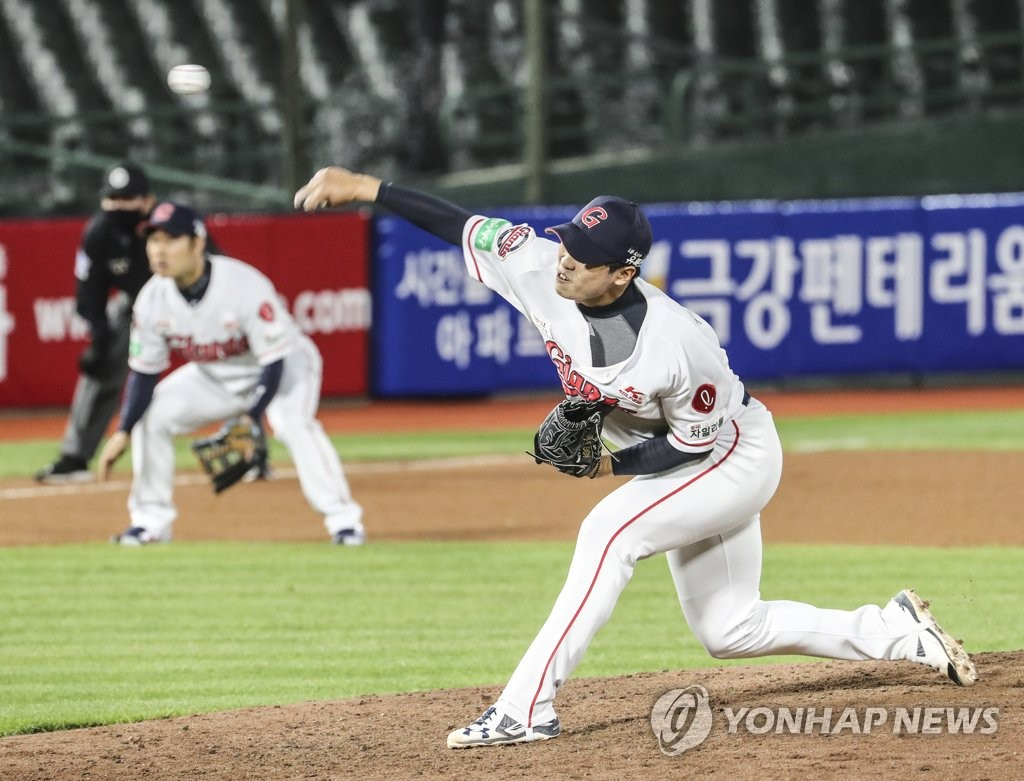 In this file photo from May 22, 2020, Koo Seung-min of the Lotte Giants pitches against the Kiwoom Heroes during their Korea Baseball Organization regular season game at Sajik Stadium in Busan, 450 kilometers southeast of Seoul. (Yonhap)