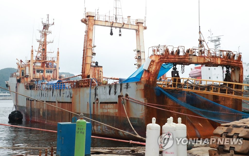 This photo, taken on July 14, 2020, shows a Tuvalu-flagged deep-sea fishing vessel docked at a port in the southeastern city of Busan, where one of its 44 crewmembers tested positive for the new coronavirus. (Yonhap)