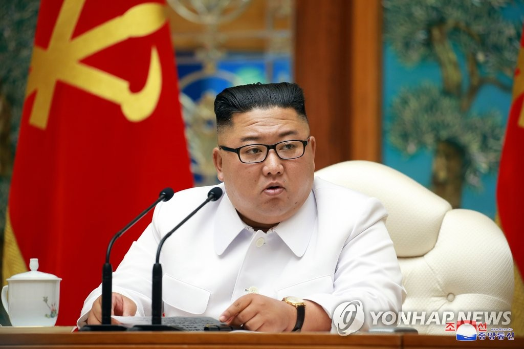 "In this photo, released by the Korean Central News Agency (KCNA) on July 26, 2020, North Korean leader Kim Jong-un presides over an emergency politburo meeting of the Workers' Party. The KCNA said Kim adopted a decision to shift to a ""maximum emergency system"" against the coronavirus in the meeting. (For Use Only in the Republic of Korea. No Redistribution)(Yonhap)"