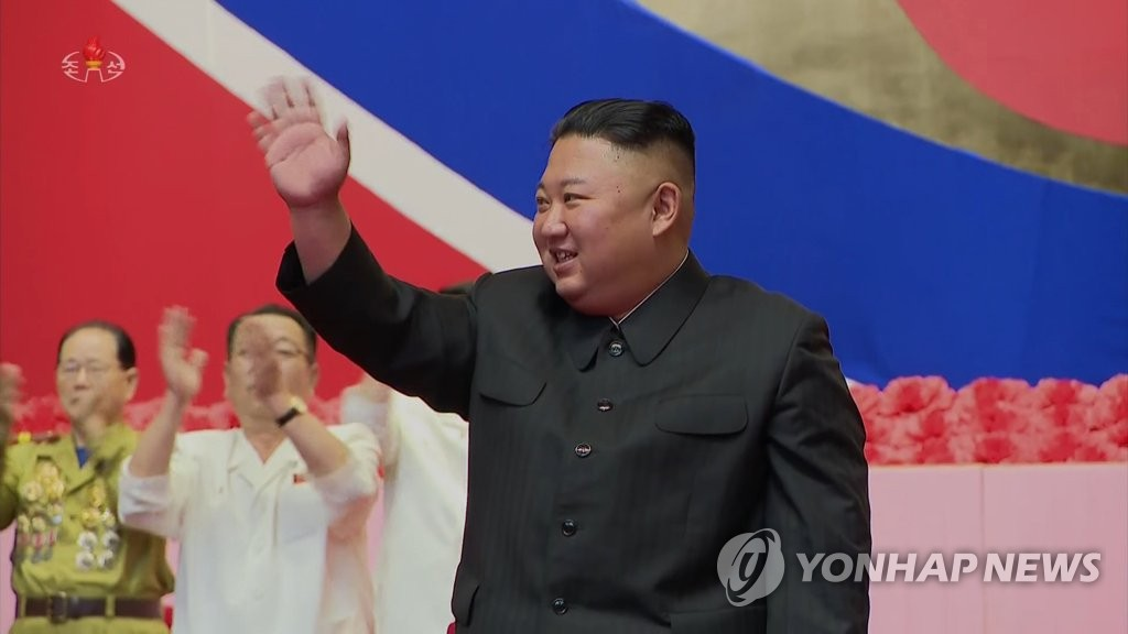 "North Korean leader Kim Jong-un waves at a national conference of veterans at the April 25 Cultural Palace in Pyongyang on July 27, 2020, in this photo captured from Korean Central Television footage on July 28. The gathering marked the 67th anniversary of the Korean War armistice that fell on the same day. The North calls the 1950-53 conflict the ""Fatherland Liberation War"" and designated the armistice signing date as Victory Day. (For Use Only in the Republic of Korea. No Redistribution) (Yonhap)"