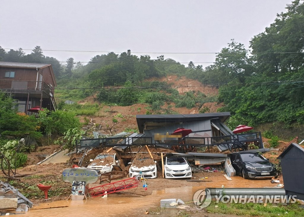 This photo, provided by fire authorities in northern Gyeonggi Province, shows an accomodation engulfed by a landslide in Gapyeong, Gyeonggi Province on Aug. 3, 2020. (PHOTO NOT FOR SALE) (Yonhap)