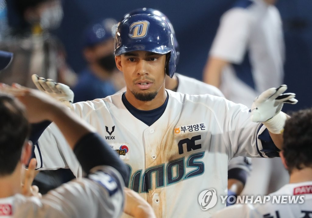 In this file photo from Aug. 29, 2020, Aaron Altherr of the NC Dinos is greeted by teammates after hitting a two-run home run against the SK Wyverns in the bottom of the seventh inning of a Korea Baseball Organization regular season game at Changwon NC Park in Changwon, 400 kilometers southeast of Seoul. (Yonhap)