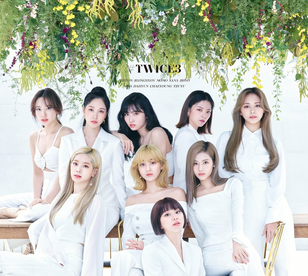 "This image provided by JYP Entertainment shows the album cover art for K-pop girl group TWICE's new compilation album ""#TWICE3"" released in Japan. (PHOTO NOT FOR SALE)"