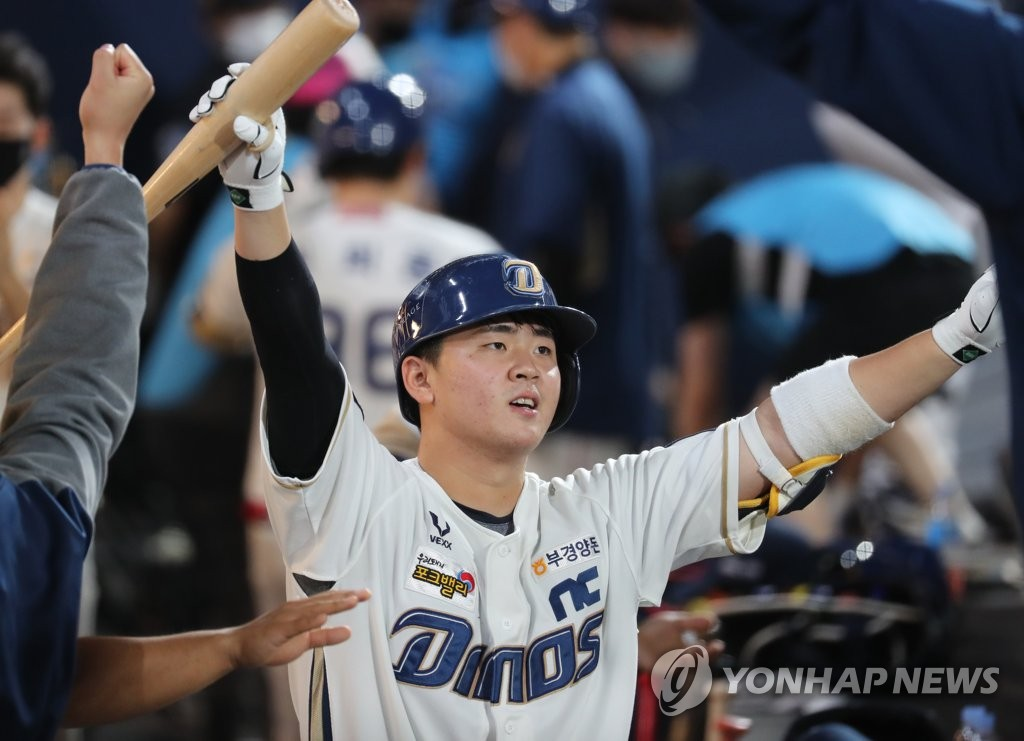 In this file photo from Sept. 25, 2020, Kim Hyung-jun of the NC Dinos is congratulated by his teammates after hitting a solo home run against the LG Twins in the bottom of the fourth inning of a Korea Baseball Organization regular season game at Changwon NC Park in Changwon, 400 kilometers southeast of Seoul. (Yonhap)