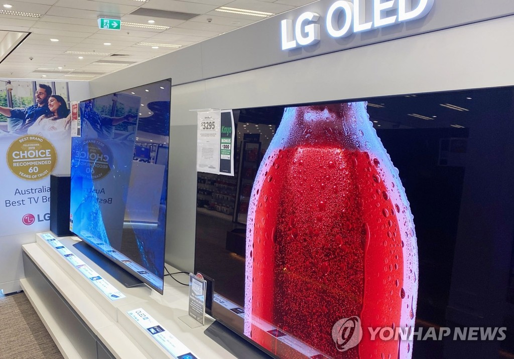 This photo provided by LG Electronics Inc. on Oct. 27, 2020, shows the company's OLED TVs displayed at a store in Australia. (PHOTO NOT FOR SALE) (Yonhap)