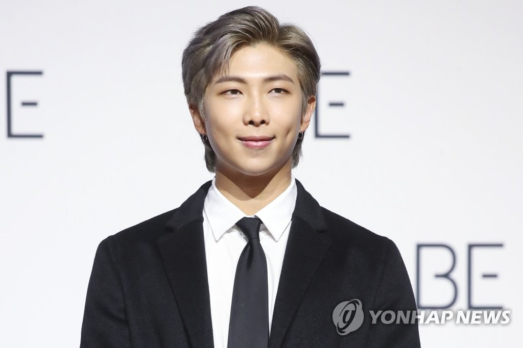 RM of BTS poses for the camera during a press conference held at the Dongdaemun Design Plaza in central Seoul on Nov. 20, 2020. (Yonhap)