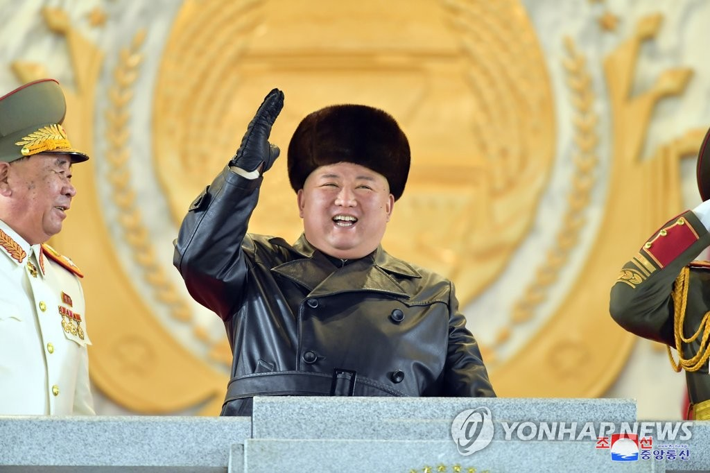 N. Korea holds military parade attended by its leader