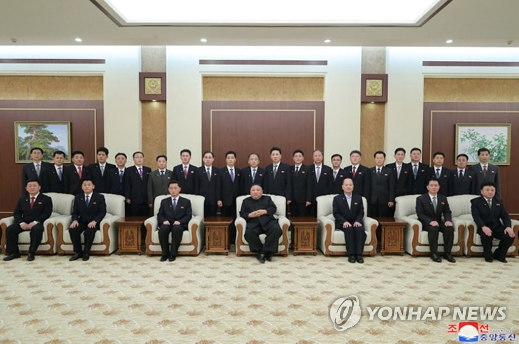 North Korean leader Kim Jong-un (C, 1st row) joins a group photo session with Premier Kim Tok-hun (3rd from L, 1st row) and other newly appointed members of the Cabinet in Pyongyang on Jan. 18, 2021, in this photo captured from the website of the North's official Korean Central News Agency the next day. (For Use Only in the Republic of Korea. No Redistribution) (Yonhap)