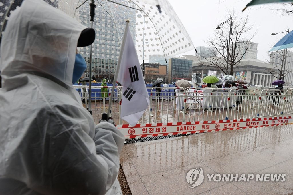 A group of protesters stages a rally at Gwanghwamun Square in Seoul on March 1, 2021. (Yonhap)