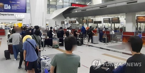 Third plane carrying S. Koreans arrives from India