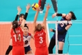 Park Jeong-ah of South Korea (R) hits a spike against Turkey in the quarterfinals of the Tokyo Olympic women's volleyball tournament at Ariake Arena in Tokyo on Aug. 4, 2021. (Yonhap)